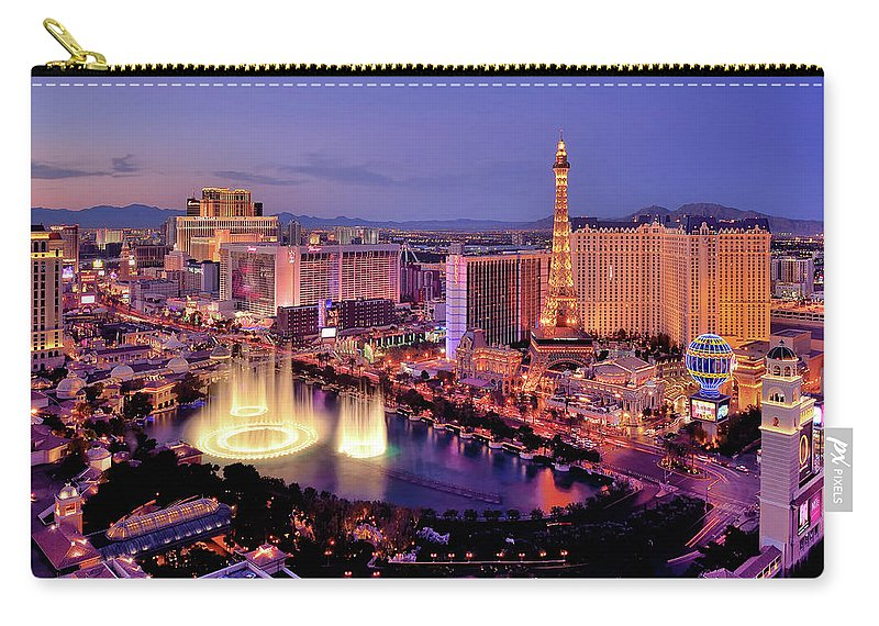 Built Structure Carry-all Pouch featuring the photograph City Skyline At Night With Bellagio by Rebeccaang