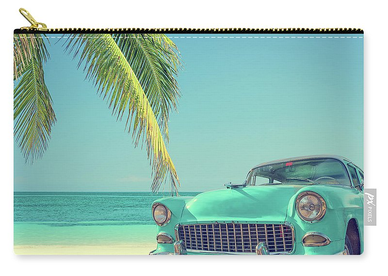 Scenics Carry-all Pouch featuring the photograph Classic Car On A Tropical Beach With by Delpixart