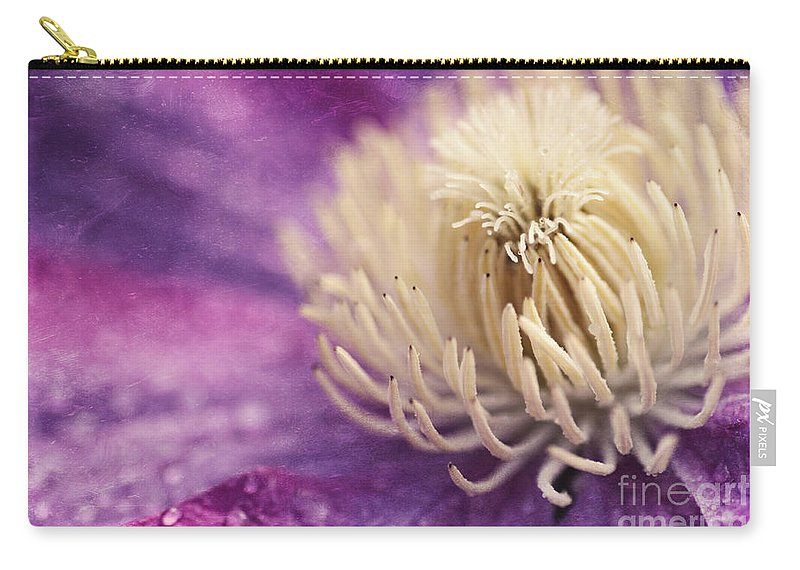 Flower Carry-all Pouch featuring the photograph Clematis-macro Photograph Of A Purple Clematis by Sylvia Cook