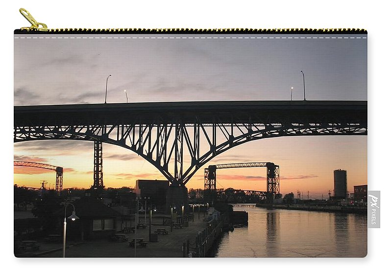Cleveland Carry-all Pouch featuring the photograph Cleveland Ohio Flats At Sunset by Wendy Gertz