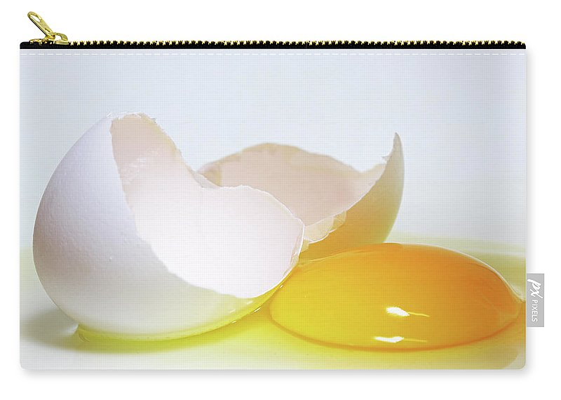 White Background Carry-all Pouch featuring the photograph Close-up Of A Broken Egg On White by Zen Rial