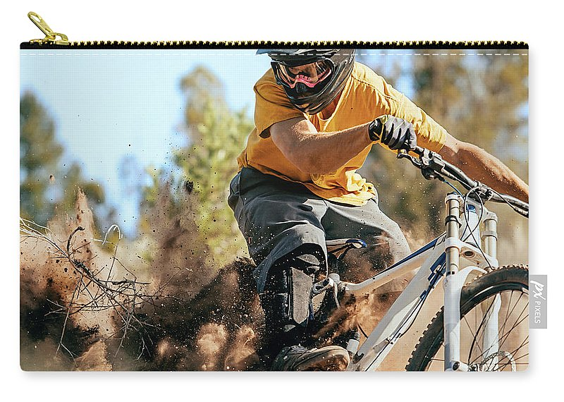 Headwear Carry-all Pouch featuring the photograph Close Up Of A Mountain Biker Ripping by Daniel Milchev