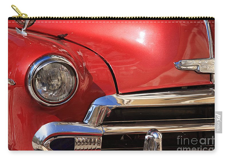 American Carry-all Pouch featuring the photograph Close Up Of A Red Chevrolet by Deborah Benbrook