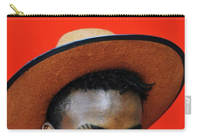 Young Men Carry-all Pouch featuring the photograph Close-up Of Man Wearing Hat Against Red by Samson Wamalwa / Eyeem