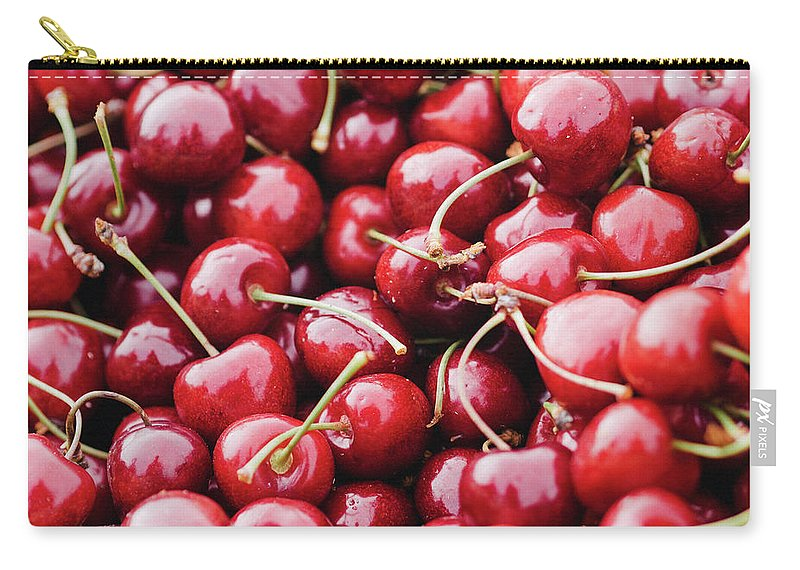 Cherry Carry-all Pouch featuring the photograph Closeup Of Fresh Cherries by Miemo Penttinen - Miemo.net