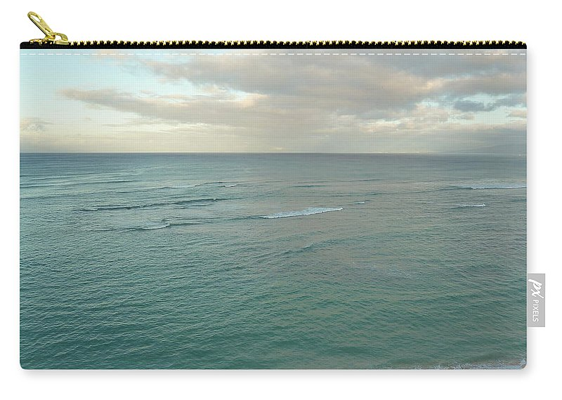 Sand Carry-all Pouch featuring the photograph Clouded Sea by Connie Handscomb