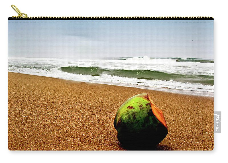 Tranquility Carry-all Pouch featuring the photograph Coconut On Sandy Beach With Waves And by Amlan Mathur
