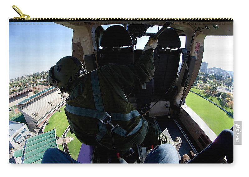 Agustawestland Aw109 Carry-all Pouch featuring the photograph Coming In To Land by Paul Job