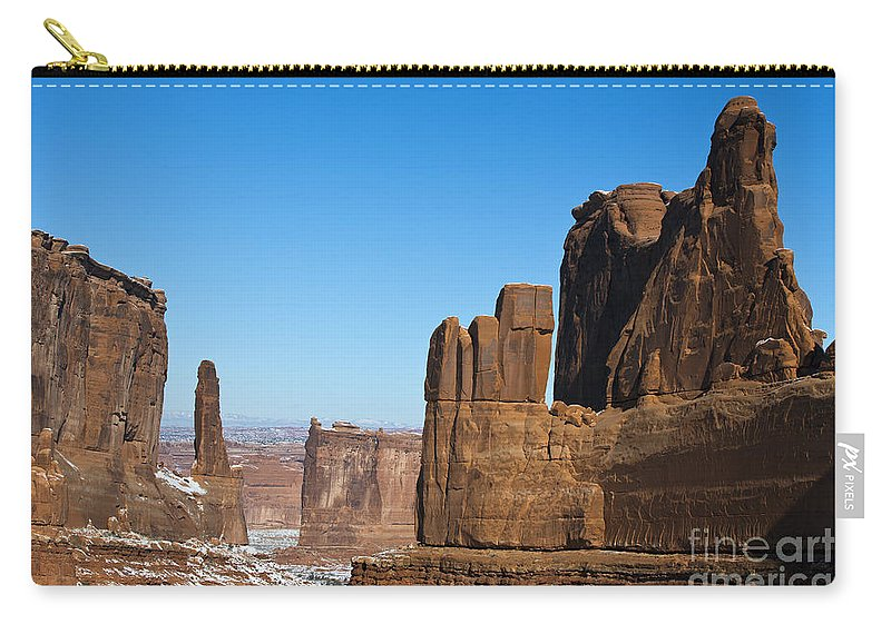 Arches Carry-all Pouch featuring the photograph Courthouse Towers Arches National Park Utah by Jason O Watson