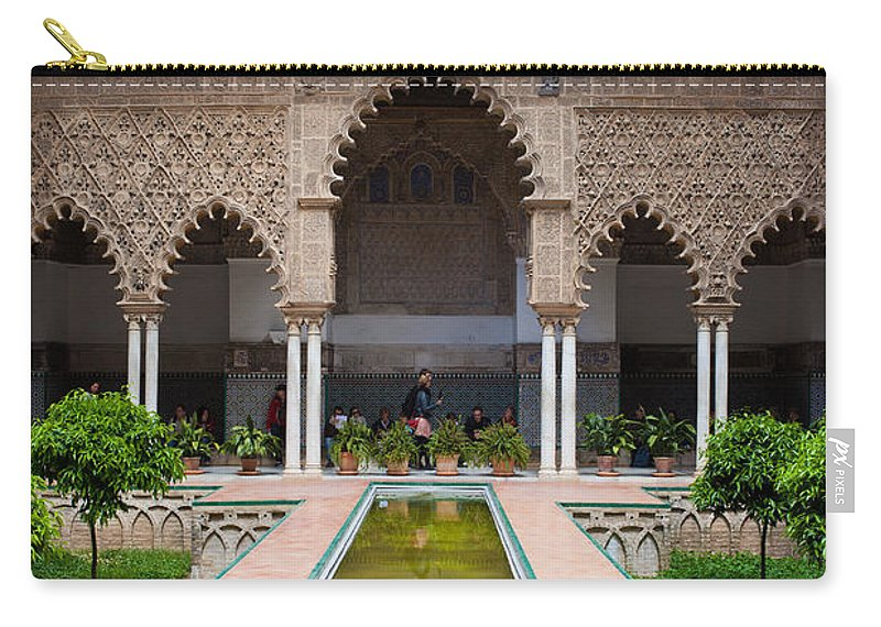 Seville Carry-all Pouch featuring the photograph Courtyard Of The Maidens In Alcazar Palace Of Seville by Artur Bogacki