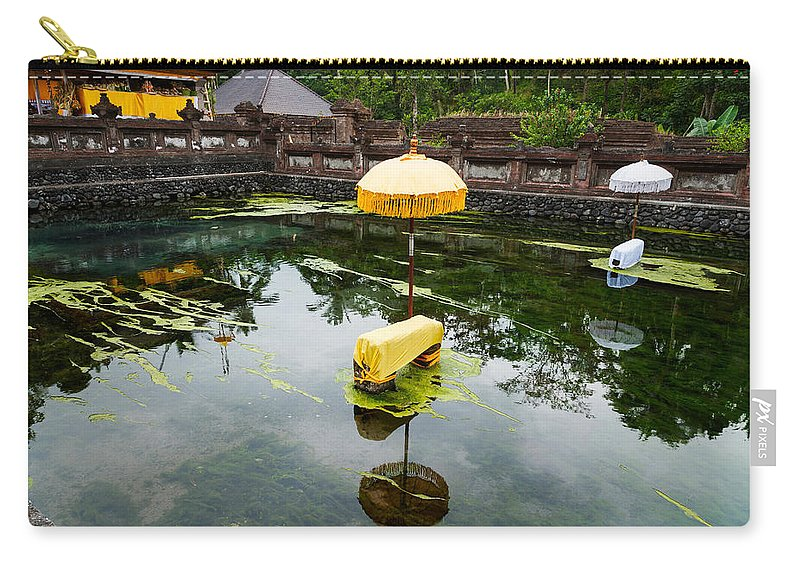 Photography Carry-all Pouch featuring the photograph Covered Stones With Umbrella In Ritual by Panoramic Images