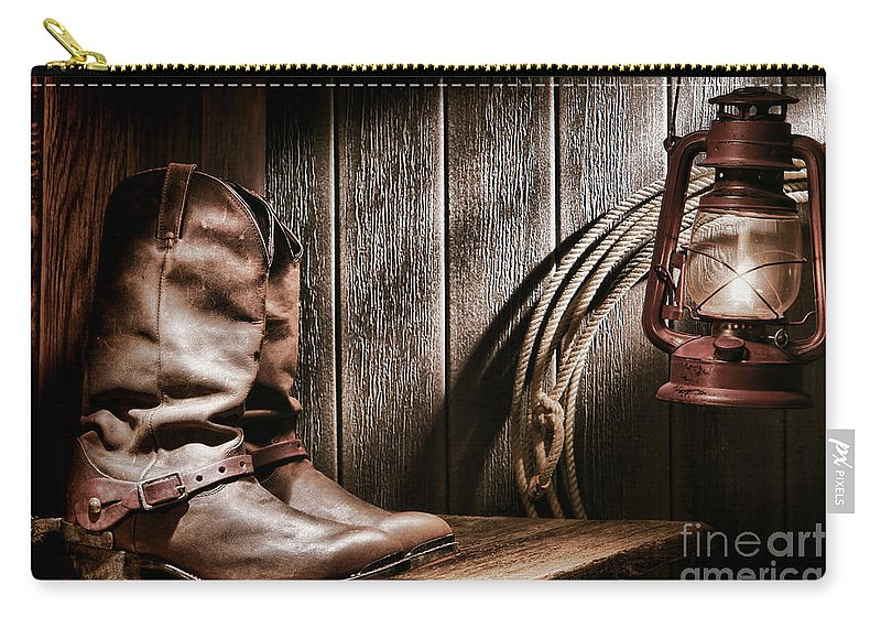 Boots Carry-all Pouch featuring the photograph Cowboy Boots In Old Barn by Olivier Le Queinec