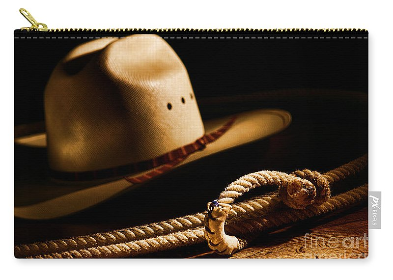 Western Carry-all Pouch featuring the photograph Cowboy Hat And Lasso by Olivier Le Queinec