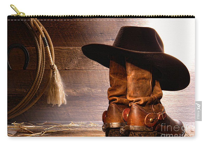 Western Carry-all Pouch featuring the photograph Cowboy Hat On Boots by Olivier  Le Queinec a7711a1fb65d