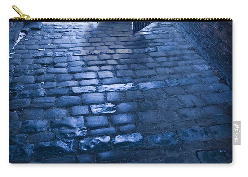 Alley Carry-all Pouch featuring the photograph Creepy Man Standing Behind A Wrought Iron Gateway by Lee Avison