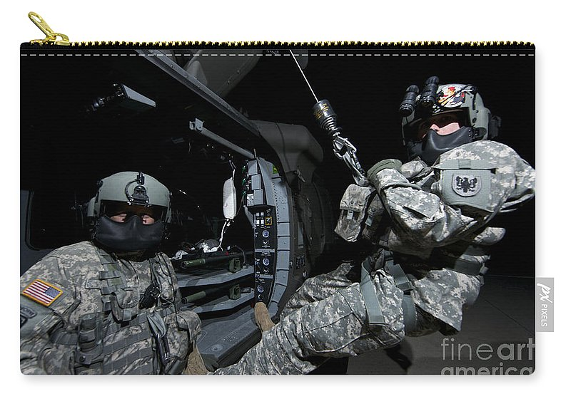 Exercise Angel Thunder Carry-all Pouch featuring the photograph Crew Chief Sits In The Doorway by Terry Moore