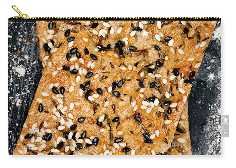 Sweden Carry-all Pouch featuring the photograph Crispbread With Thyme On Metal Sheet by Johner Images