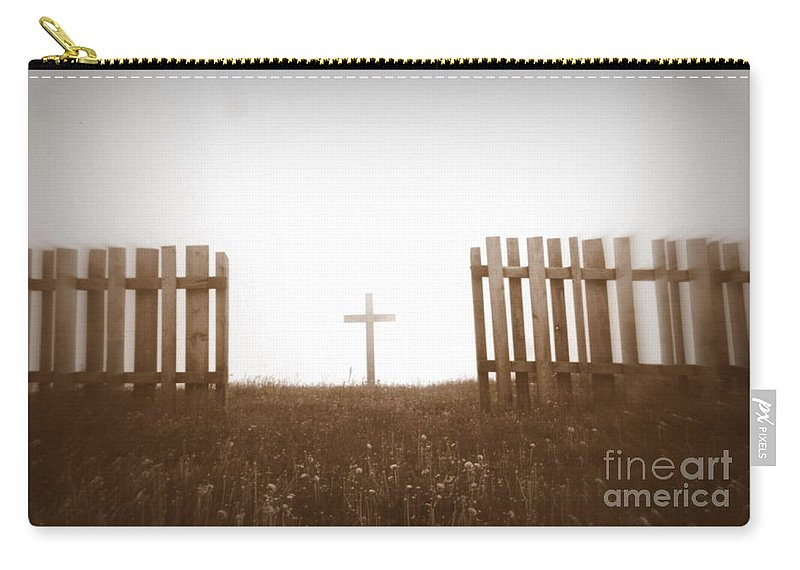 Christ Carry-all Pouch featuring the photograph Cross Between The Fences by Amanda Mohler