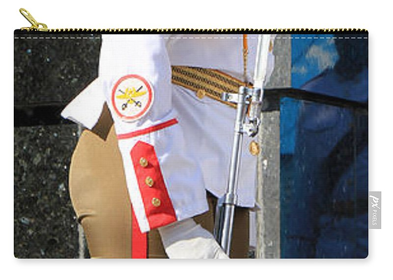 Cuba Carry-all Pouch featuring the photograph Cuban Soldier 1 by Andrew Fare