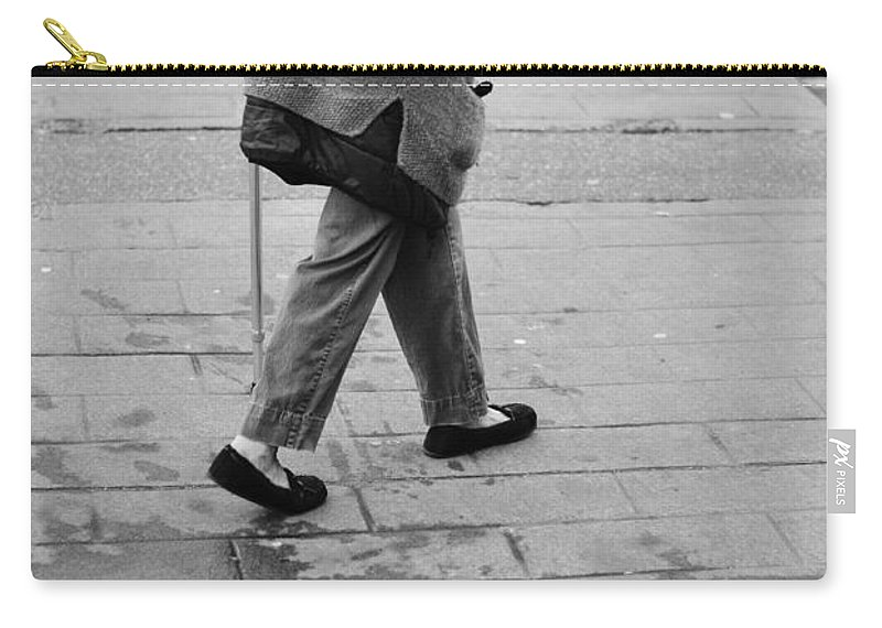 Street Photography Carry-all Pouch featuring the photograph Daily News by The Artist Project