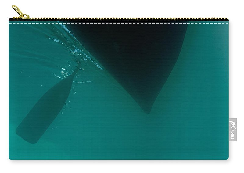 Above Carry-all Pouch featuring the photograph Dark Paddle Canoe Hull Silhouette Floating by Stephan Pietzko