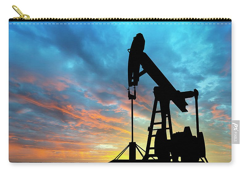 Shadow Carry-all Pouch featuring the photograph Dawn Over Petroleum Pump by Grafissimo