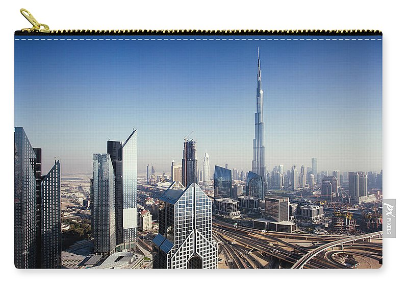 Downtown District Carry-all Pouch featuring the photograph Dbuai Sky Line With Traffic Junction by Tempura