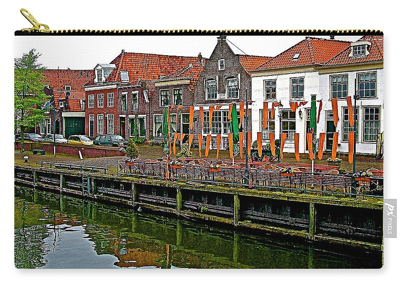 Decorations For Orange Day To Celebrate The Queen's Birthday In Enkhuizen Carry-all Pouch featuring the photograph Decorations For Orange Day To Celebrate The Queen's Birthday In Enkhuizen-netherlands by Ruth Hager