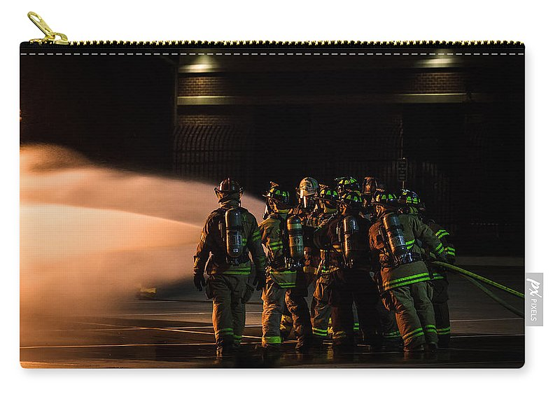 Extinguish Carry-all Pouch featuring the photograph Dedication by Sennie Pierson
