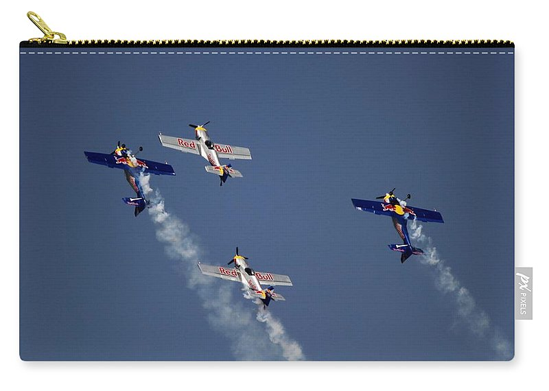 Red Bulls Aerobatics Carry-all Pouch featuring the photograph Defying Law Of Gravity by Ramabhadran Thirupattur
