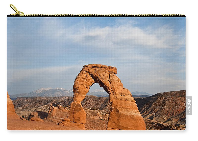 Arch Carry-all Pouch featuring the photograph Delicate Arch At Sunset by Jeff Goulden