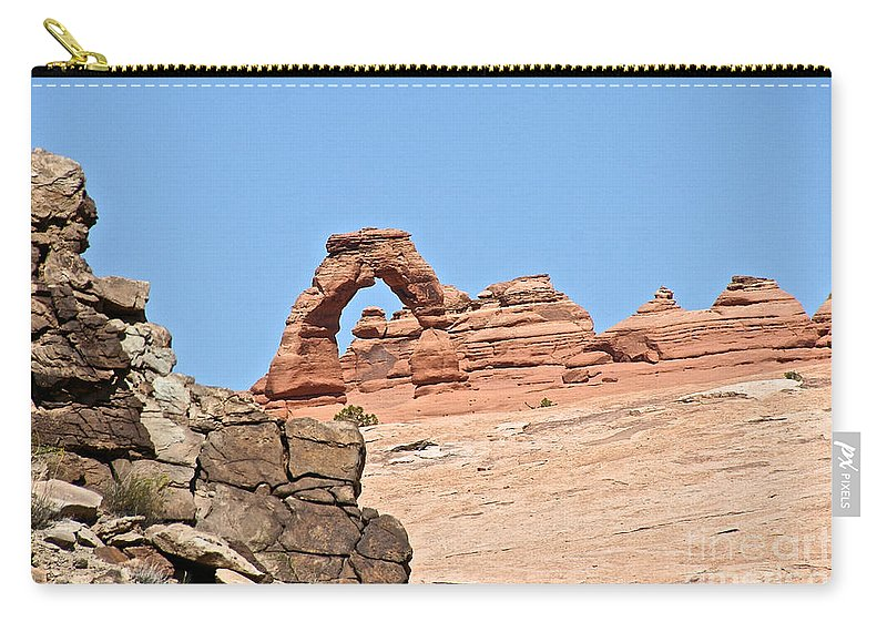 Utah Carry-all Pouch featuring the photograph Delicate Arch by Susan Herber