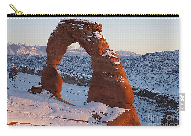Arches Carry-all Pouch featuring the photograph Delicate Arch With Snow Arches National Park Utah by Jason O Watson
