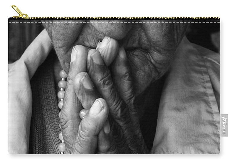 Devotion Carry-all Pouch featuring the photograph Devoted by Bob Christopher