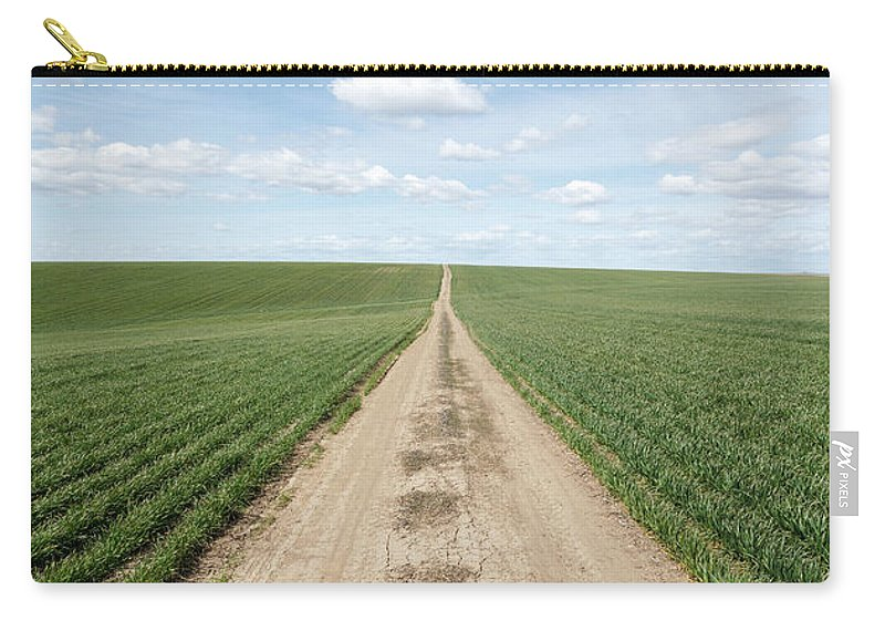 Tranquility Carry-all Pouch featuring the photograph Dirt Road And Farmland by Adrian Studer