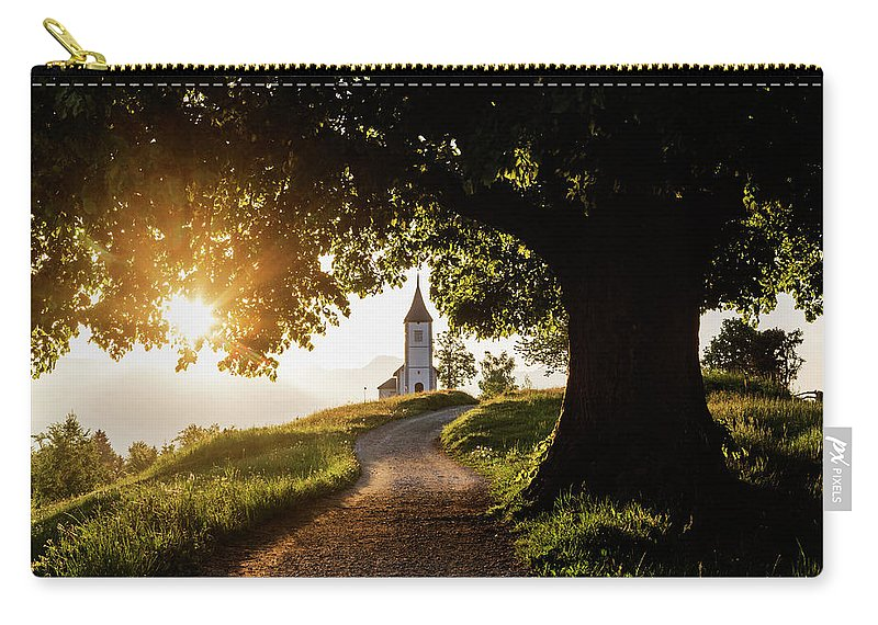 Tranquility Carry-all Pouch featuring the photograph Dirt Road Leading To Remote Hilltop by Pixelchrome Inc