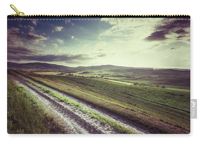 Steppe Carry-all Pouch featuring the photograph Dirt Track In Tuscany by Xavierarnau
