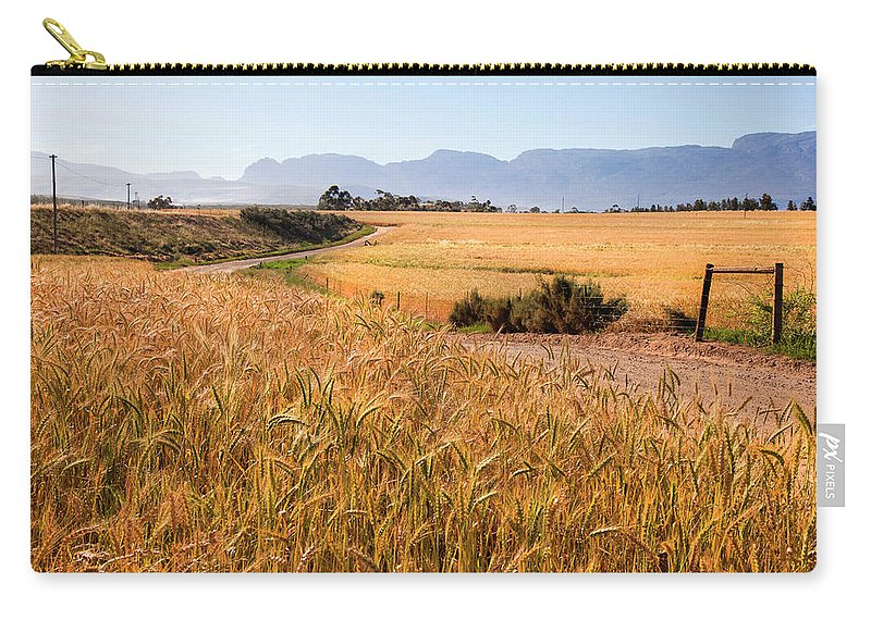 Tranquility Carry-all Pouch featuring the photograph Dirt Track Leading Through Wheat by Douglas Holder