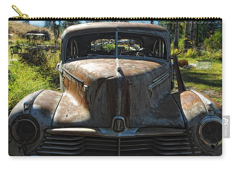 Car Carry-all Pouch featuring the photograph Discarded Love by Donna Blackhall