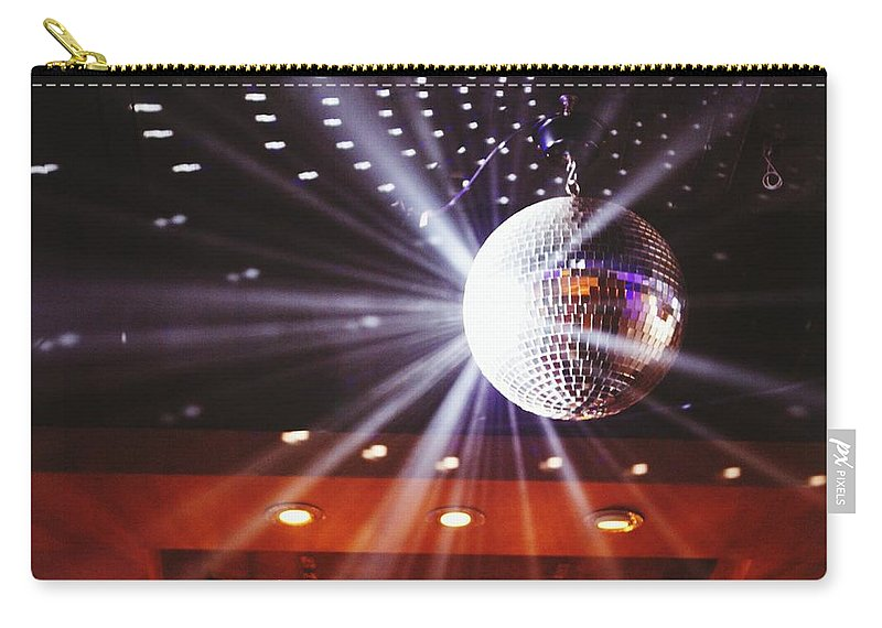 Hanging Carry-all Pouch featuring the photograph Disco Ball At Illuminated Nightclub by Shaun Wang / Eyeem