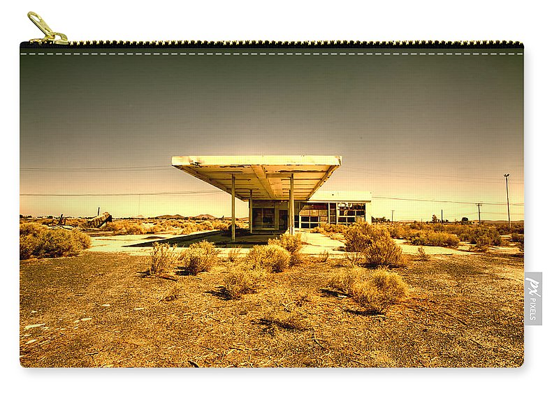Abandoned Carry-all Pouch featuring the photograph Dollar Twenty Five A Gallon by Peter Tellone