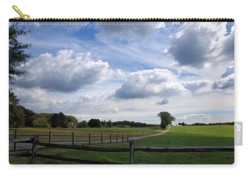 Dramatic Blustery Sky Over The Hayfield Carry-all Pouch featuring the photograph Dramatic Blustery Sky Over The Hayfield by Byron Varvarigos