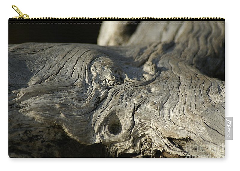 Driftwood Carry-all Pouch featuring the photograph Driftwood by Evelyn Hill