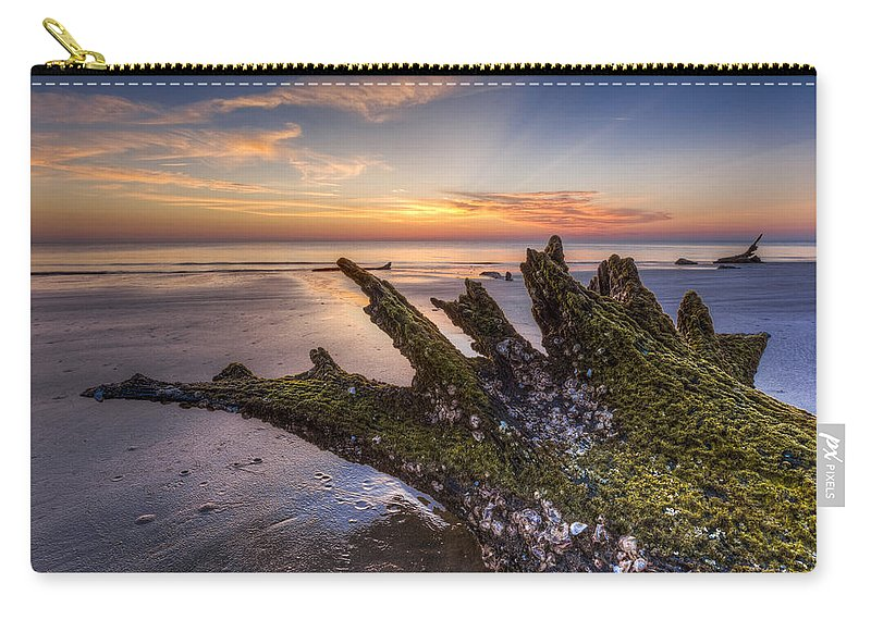 Clouds Carry-all Pouch featuring the photograph Driftwood On The Beach by Debra and Dave Vanderlaan