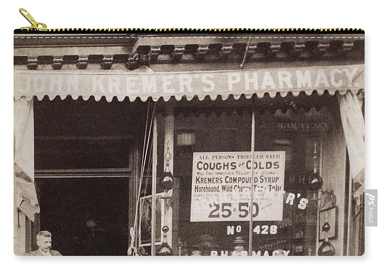 1890 Carry-all Pouch featuring the photograph Drugstore, 1890 by Granger