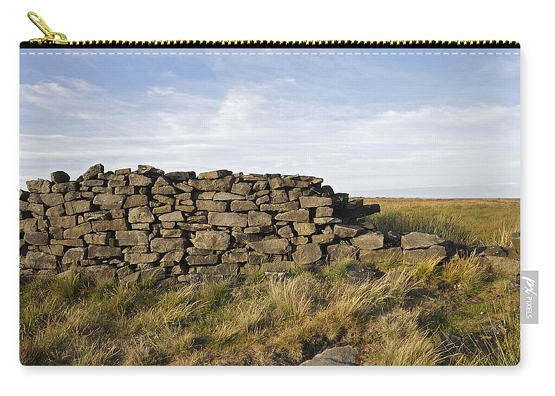 Abandoned Carry-all Pouch featuring the photograph Dry Stone Wall by Kevin Round