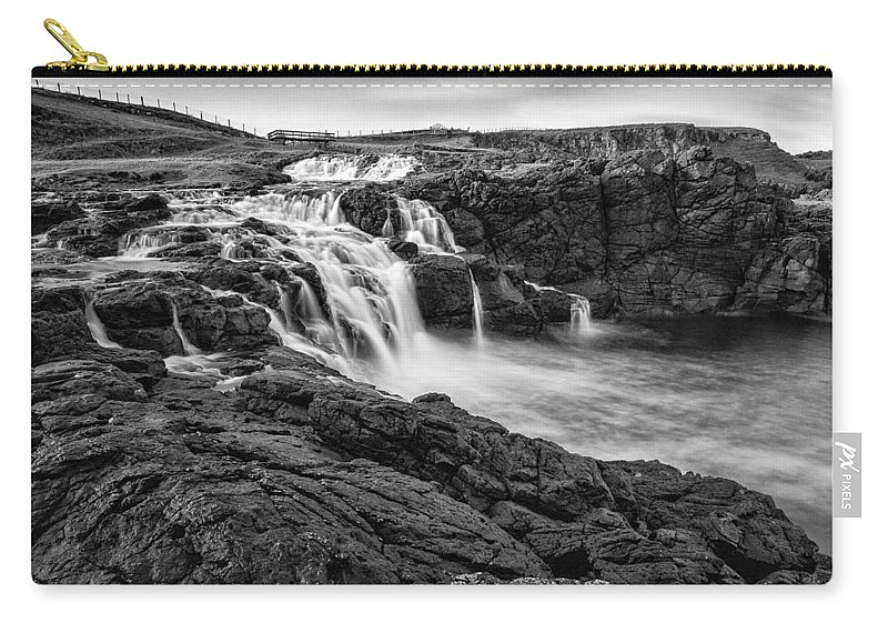 Dunseverick Carry-all Pouch featuring the photograph Dunseverick Waterfall by Nigel R Bell
