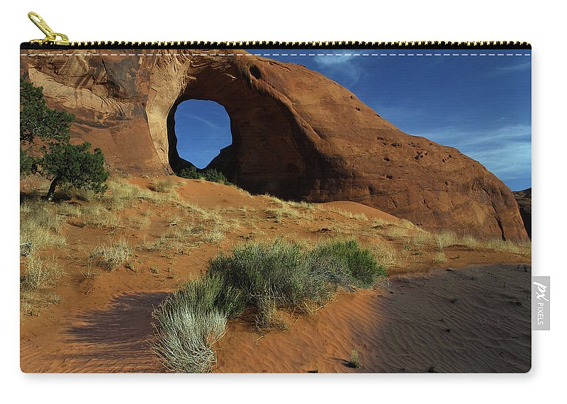 Ear Of The Wind Arch Carry-all Pouch featuring the photograph Ear Of The Wind Arch by Dave Mills