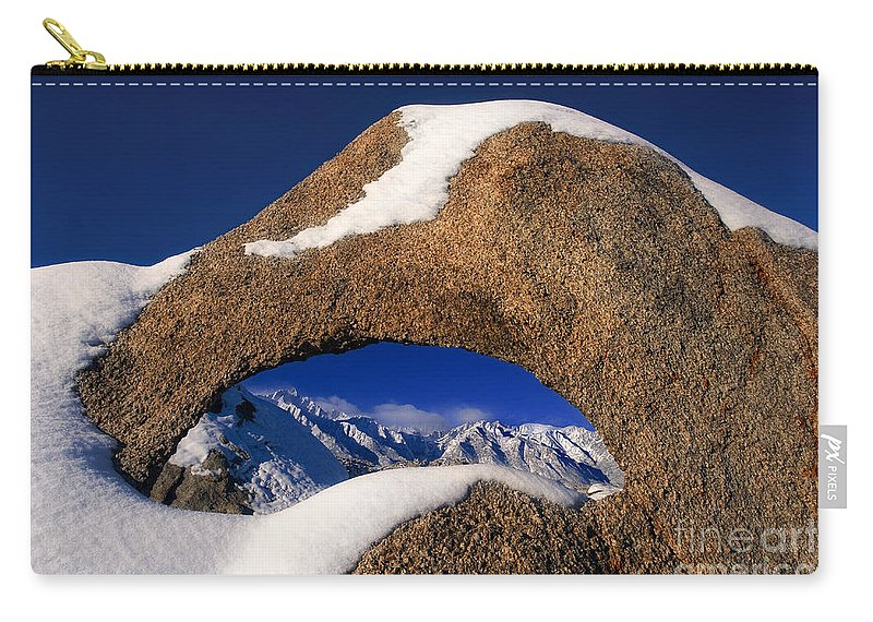 North America Carry-all Pouch featuring the photograph Eastern Sierras Through Snow Covered Arch by Dave Welling