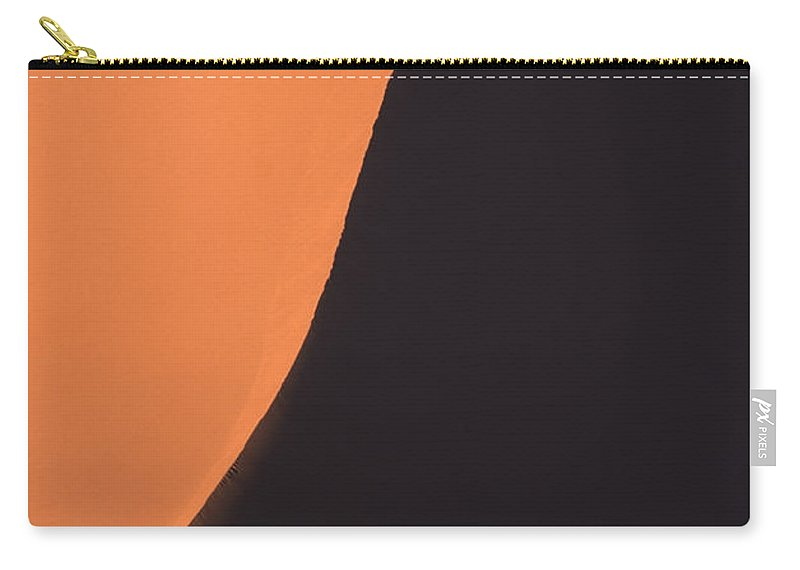 Tranquility Carry-all Pouch featuring the photograph Edge Of Giant Red Sand Dune by Rosemary Calvert